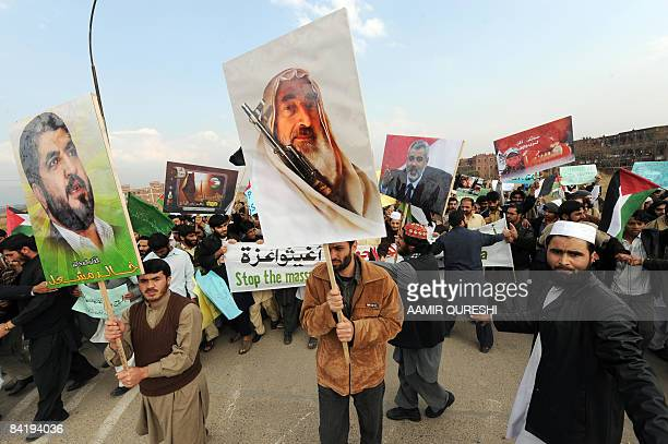 Students of Pakistani International Islamic University carry posters of Sheikh Ahmed Yassin founder of Hamas and its leader Khaled Meshaal as they...