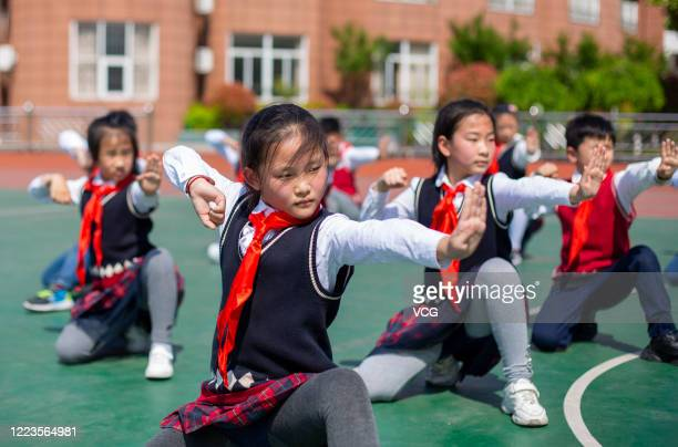 HAI'AN CHINA MAY 07 Students of primary school affiliated to Haian Teachers's Development Center practice traditional martial arts on May 7 2020 in...