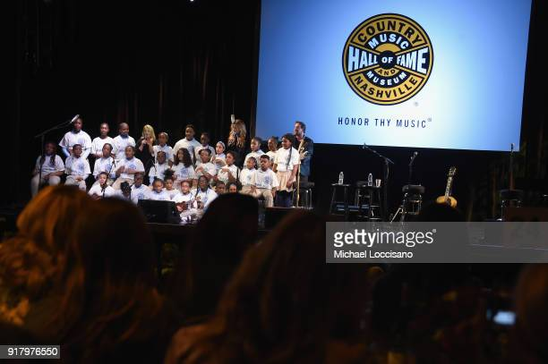 Students of PS169 Baychester Academy perform with Liz Rose Carly Pearce and Phil Barton onstage at the Country Music Hall of Fame and Museum's 'All...