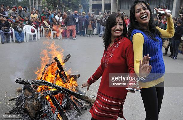 Students of Punjab University performing Gidda during celebrations of Lohri festival on January 13 2014 in Chandigarh India