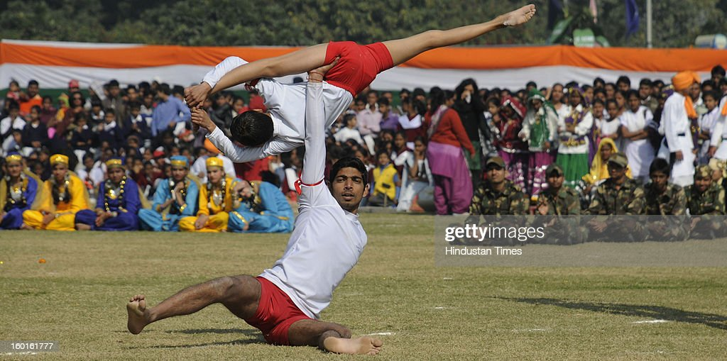Students of Rao Ram Singh public school perform the YOGA during the 64th Republic Day parade in Devi Lal Stadium on January 26, 2013 in Gurgaon, India. India marked its Republic Day with celebrations held under heavy security, especially in New Delhi where large areas were sealed off for an annual parade of military hardware.