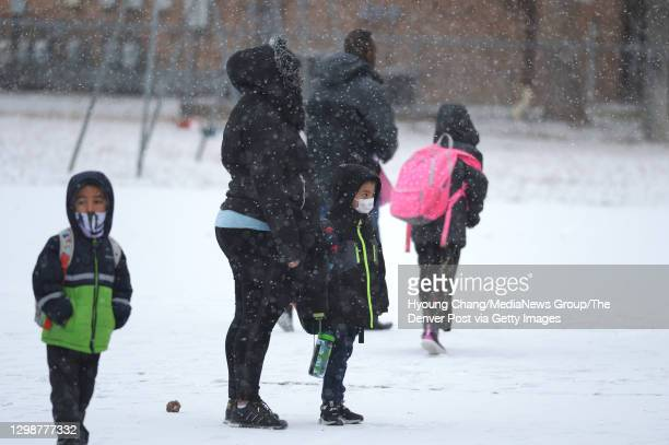 Students of Rose Hill Elementary are heading to their assigned entrance with their parents at the school in Commerce City, Colorado on Tuesday....