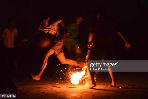 Students of Salafiyah Boarding School play fire football a game played with a fire ball of coconut soaked of kerosene on fire on June 21 2016 in...