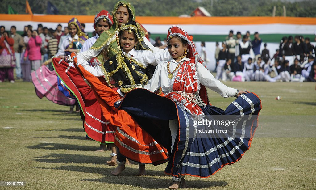 Students of Sardha International school perform the Haryanvi folk dance during the 64th Republic Day parade in Devi Lal Stadium on January 26, 2013 in Gurgaon, India. India marked its Republic Day with celebrations held under heavy security, especially in New Delhi where large areas were sealed off for an annual parade of military hardware.