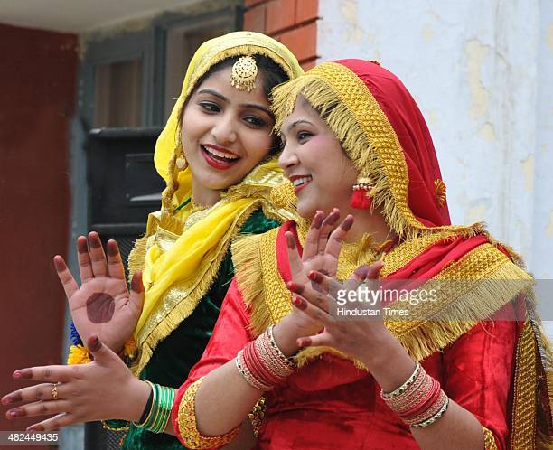Students of Shahzada Nand College wearing traditional Punjabi dresses performing Gidda during celebrations of Lohri festival on January 13 2014 in...