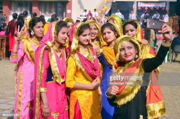 Students of Shahzada Nand College wearing traditional Punjabi dresses and performing gidha on the occasion of Lohri festival, on January 13, 2018 in...