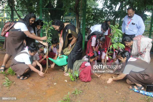 Students of Smt Sulochanadevi Singhania school plant trees in the school premises along with the students of Pandit School a tribal school in Yeoor...