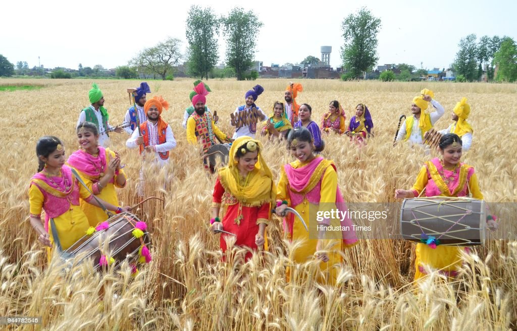 Students of Sri Guru Harkrishan Senior Secondary Public School Sultanwind Link Road performing Bhangra in a traditional dress at wheat field during...