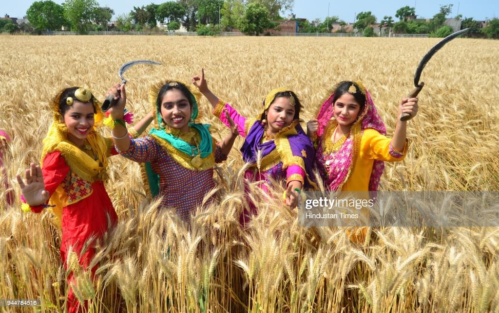 Students of Sri Guru Harkrishan Senior Secondary Public School Sultanwind Link Road in a traditional dress pose at wheat field during Baisakhi...