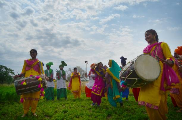 Students of Sri Guru Harkrishan Senior Secondary Public School Sultanwind Link Road performing Geedha in a traditional dress at wheat field during...