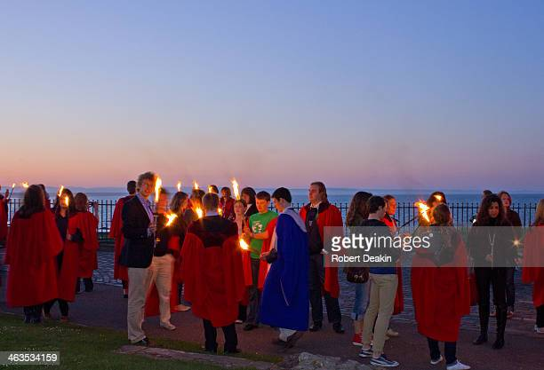 Students of St Andrews University pause at canons before continuing down to the end of the pier. Once here they throw the flames into the sea in...