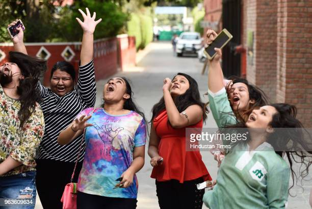 Students of St Thomas' Girls Senior Secondary School celebrate after Central Board of Secondary Education announced the results of Class 10 board...