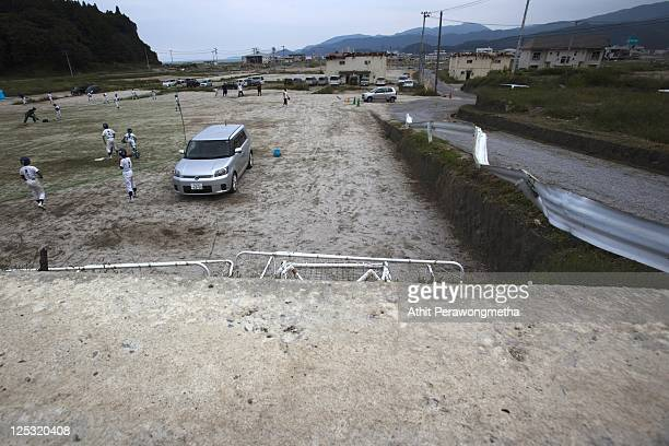 Students of Takada Elementary school attend a baseball class prior to the sixth month anniversary of the March 11 earthquake and massive tsunami on...
