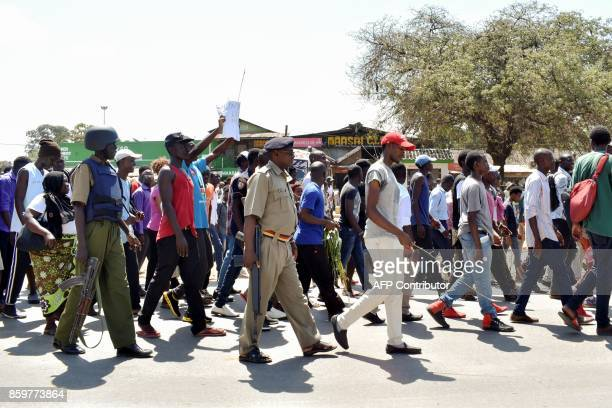 Students of Technical University of Mombasa protest after two university employees were shot dead on a car by gunmen on their way to the University...