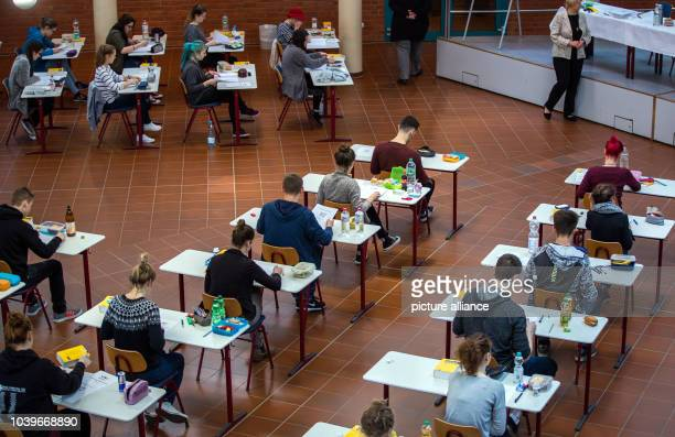 Students of the 12th grade participate in the written 'Abitur' exam the final examination of the secondary school in the subject 'German' at the...