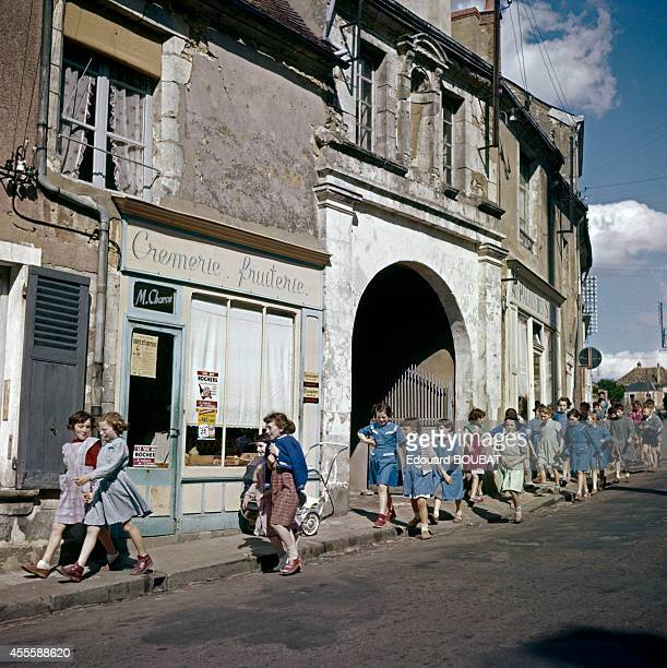 Students of the 8th class walking through the city of NogentleRotrou for an open air class 1957 in NogentleRotrou France