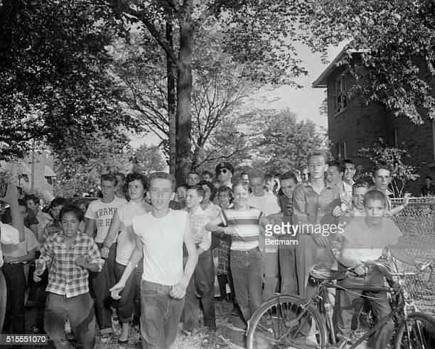 Students of the Anacostia High School are shown running after some Negro school children as a local schools today in protest against the end of...