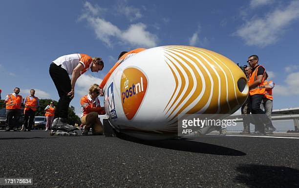 Students of the Delft Technical University and the Amsterdam Free University take part in a bike speed record attempt event with the aerodynamic bike...