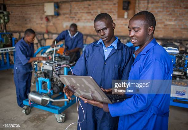 Students of the ETEKA vocational school inspecting a motor a teacher is present to assist them on February 06 2014 in Kabgayi Rwanda The ETEKA is a...