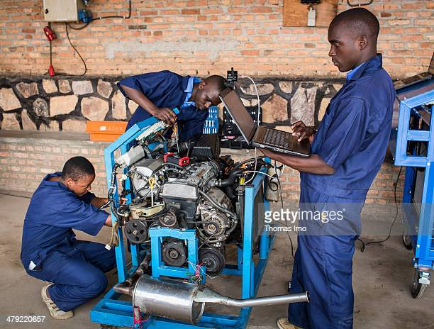 Students of the ETEKA vocational school inspecting a motor on February 06 2014 in Kabgayi Rwanda The ETEKA is a vocational school for trainees in the...