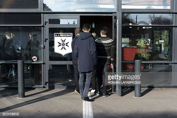 Students of the French School of Football Players' Agents enter the training center of the French football club AJ Auxerre prior to a visit on...