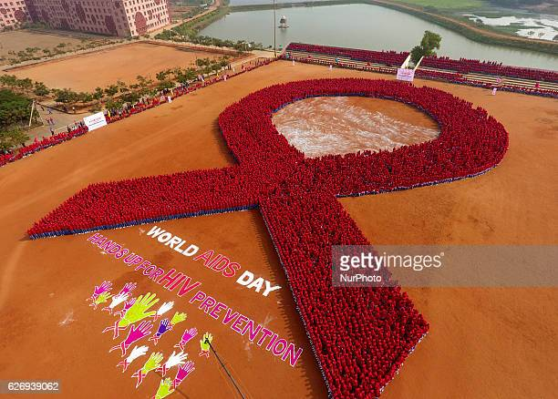 Students of the KISS stand in a human chain as they build Red Ribbon logo of HIV AIDs and make the Guinness Book of World record in the eastern...