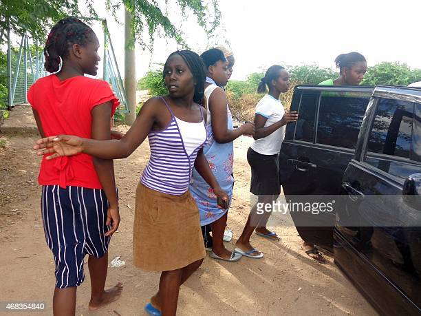 Students of the Moi University leave after escaping an attack by Somalia's Al-Qaeda-linked Shebab gumen in Garissa on April 2, 2015. Shebab gunmen...