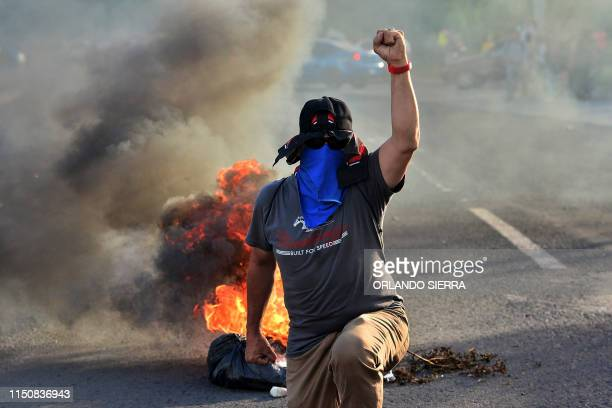 TOPSHOT Students of the National Autonomous University of Honduras block a road in Tegucigalpa on June 19 2019 during a protest against the...