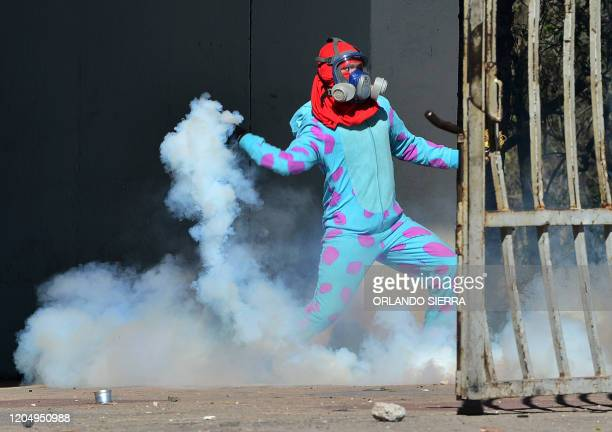TOPSHOT Students of the National Autonomous University of Honduras clash with riot police during a protest demanding justice for the murder of...