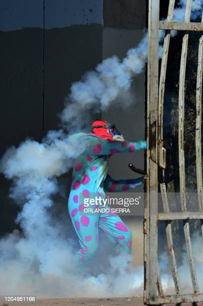 Students of the National Autonomous University of Honduras clash with riot police during a protest demanding justice for the murder of indigenous...