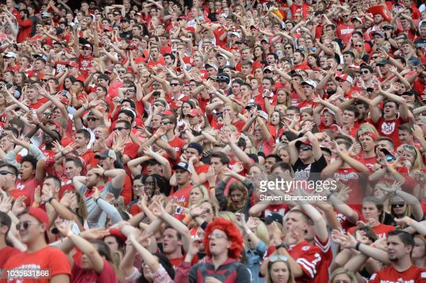 Students of the Nebraska Cornhuskers cross arms in support of the defense during the game against the Colorado Buffaloes at Memorial Stadium on...
