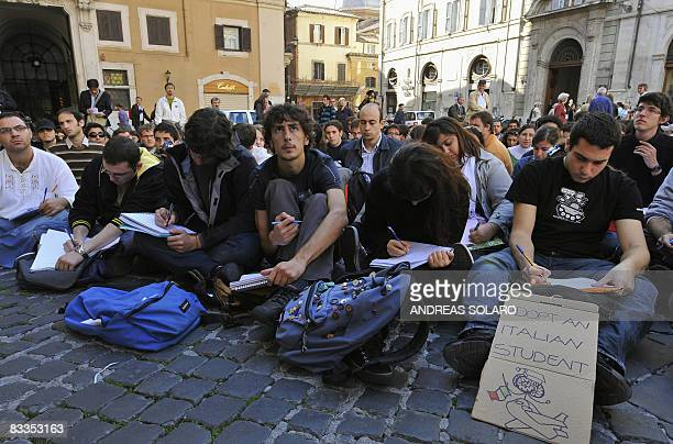 Students of the physics department of Rome's Sapienza university attend a lesson outside the Italian Parliament on October 20 2008 in Rome to protest...