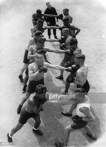 Students of the police academy in Spandau learning the basic rules of boxing Photograph Germany Around 1930 [Junge PolizeiStudenten lernen die...
