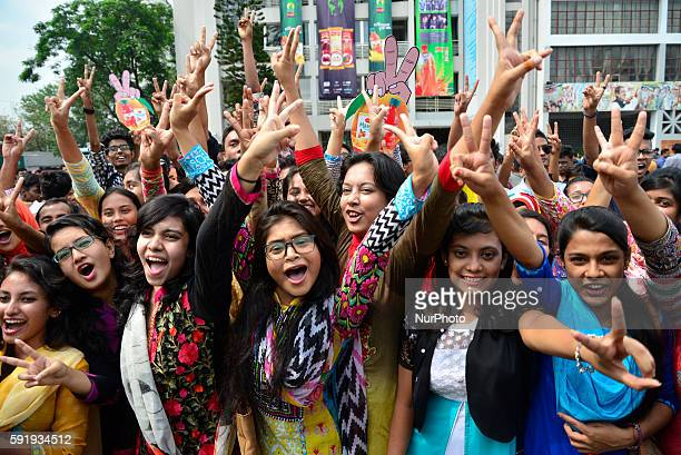 Students of the Rajuk Uttara Model College in Dhaka flash victory signs after getting GPA5 in the HSC exams on August 18 2016 in Dhaka Bangladesh The...