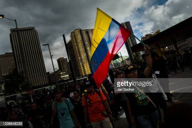 Students of the Universidad Nacional de Colombia carrying the Colombian flag take part in a protest march against government's policies and...