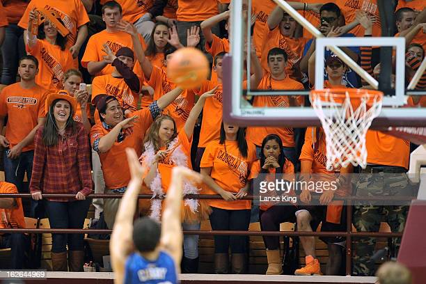 Students of the Virginia Tech Hokies try to distract Seth Curry of the Duke Blue Devils during a free throw attempt at Cassell Coliseum on February...