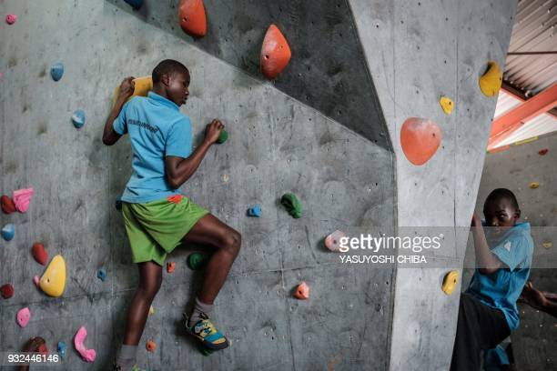 Students of Thika school for the Blind challenge bouldering on the artificial climbing wall during a weeklong free climbing training by the Japanese...