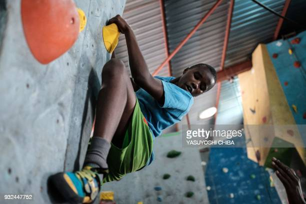 A students of Thika school for the Blind challenges bouldering on the artificial climbing wall during a weeklong free climbing training by the...