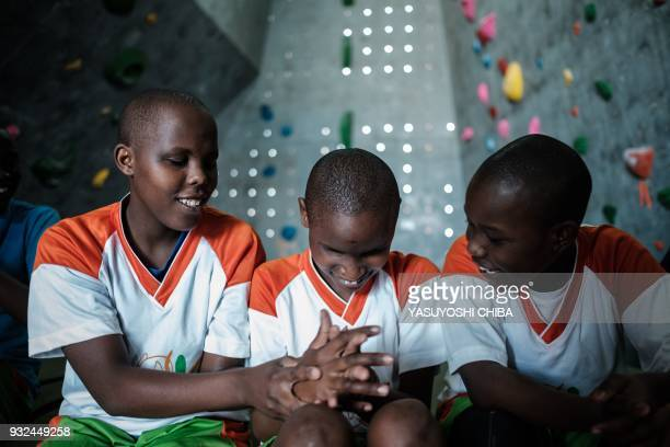 Students of Thika school for the Blind warm up their wrists before bouldering during a weeklong climbing training by the Japanese NPO Monkey Magic in...