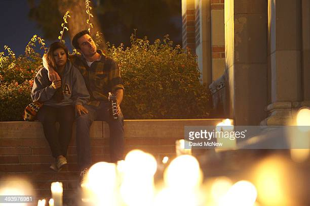 Students of UCSB and UCLA mourn at a candlelight vigil at UCLA for the victims of a killing rampage over the weekend near UCSB on May 26 2014 in Los...