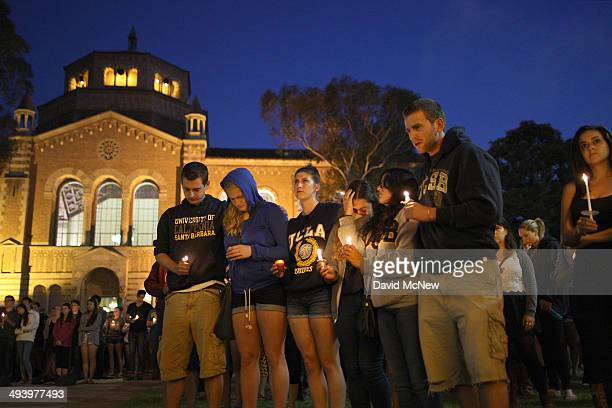 Students of UCSB and UCLA mourn at a candlelight vigil at UCLA for the victims of a killing rampage over the weekend near UCSB on May 26, 2014 in Los...