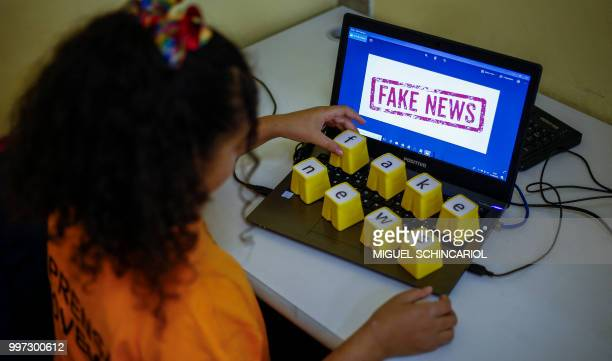 Students of Unified Educational Centers attend a lesson on 'Fake News access security and veracity of information' in Sao Paulo Brazil on June 21...