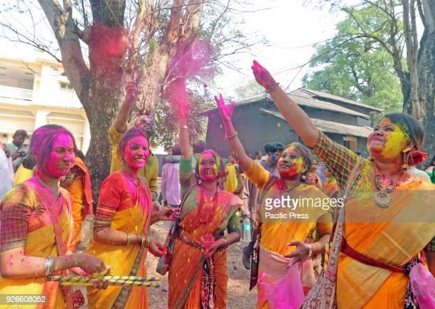 Students of VisvaBharati University play with colour powder during celebration of Basanta Utsav to mark 'Holi' Rabindranath Tagore first Nobel...