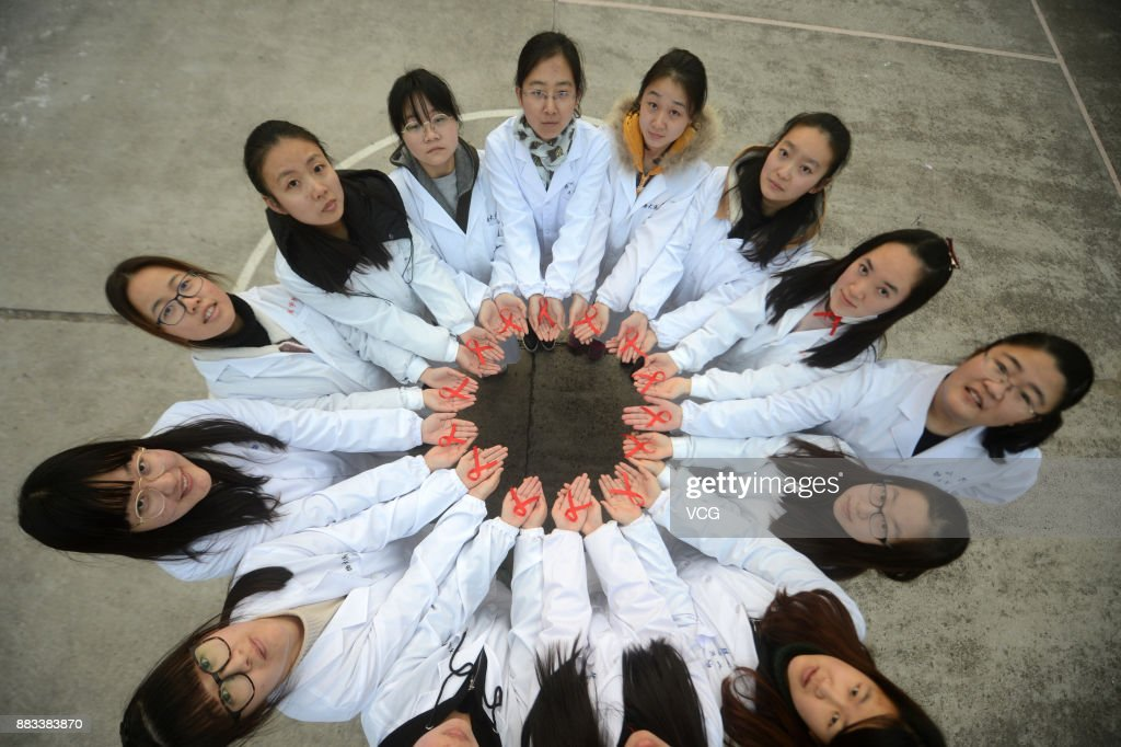 Students of Yangzhou University Medical College show red ribbons on November 30, 2017 in Yangzhou, Jiangsu Province of China. Yangzhou University organized theme activities to raise awareness of the AIDS pandemic caused by the spread of HIV infection. World AIDS Day is observed on December 1st every year since 1988.