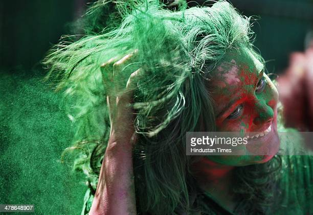 Students of YMCA celebrate with colours before Holi festival Near YMCA road side on March 14 2014 in New Delhi India Holi is a festival of colors...