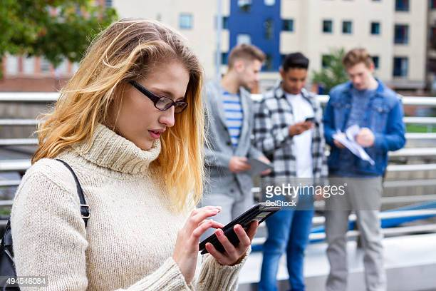 Students on Campus on their Mobile Devices
