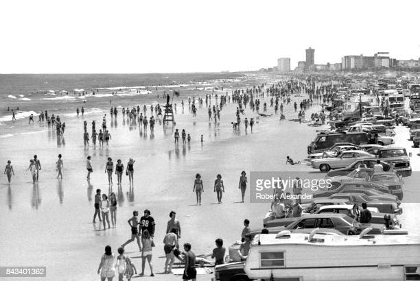 Students on Spring Break and other visitors to Daytona Beach Florida crowd the beach in 1983