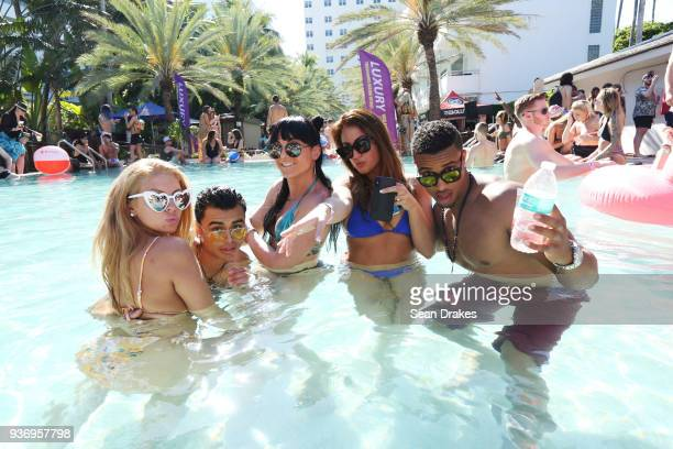 Students on Spring Break attend the MK Area 10 Party hosted by 935FM Revolution Radio Miami at the National Hotel on South Beach as part of Miami...