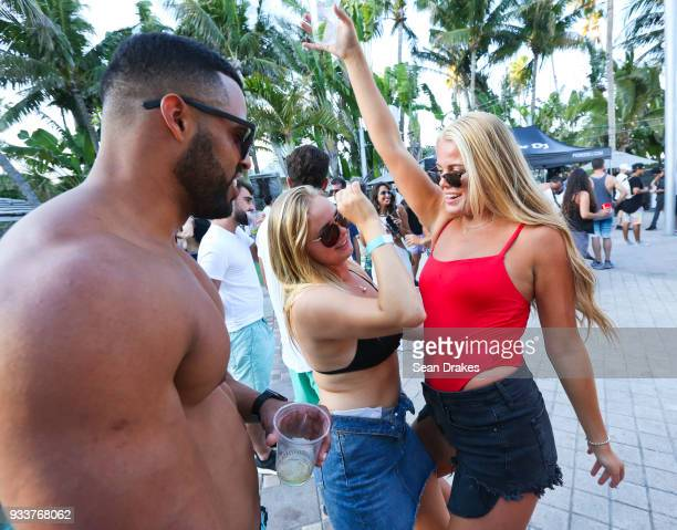 Students on Spring Break dance to DJ music during the launch pool party produced by 935FM Revolution Radio Miami at the Nationl Hotel on South Beach...