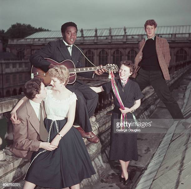 Students on the roof of Trinity College in Cambridge with the Wren Library in the background during May Week June 1954 The young man at the back is...